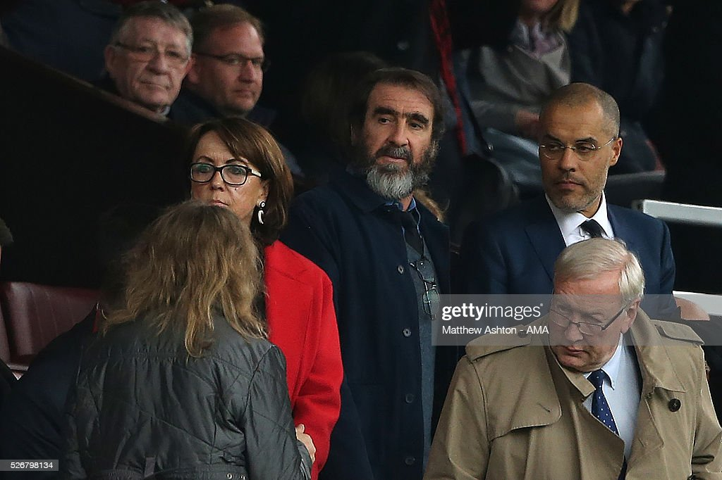 Ex-Manchester United player <a gi-track='captionPersonalityLinkClicked' href=/galleries/search?phrase=Eric+Cantona&family=editorial&specificpeople=211325 ng-click='$event.stopPropagation()'>Eric Cantona</a> looks on during the Barclays Premier League match between Manchester United and Leicester City at Old Trafford on May 1, 2016 in Manchester, United Kingdom.