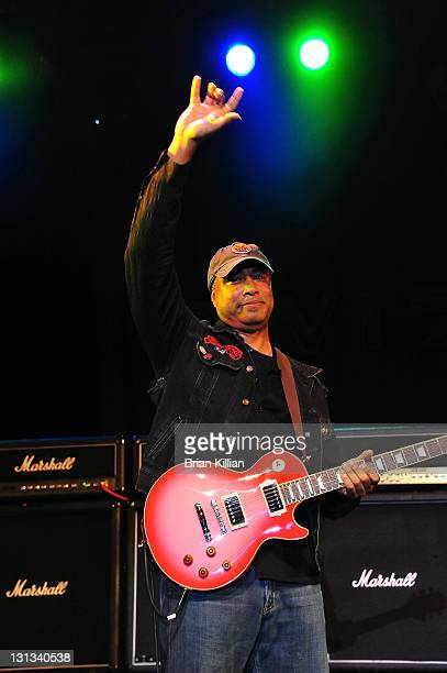 ExNew York Yankee outfielder Bernie Williams performs with the band Twisted Sister during the Pinkburst Project benefit for the Ocular Immunology and...