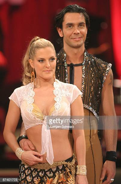 ExNo Angels singer Sandy Moelling and dancer Roberto Albanese stand close after their performance at the dancing competition show on TV station RTL...