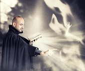 Exorcist priest fights a demon in a dark room
