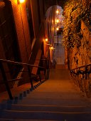 Photo of the famous Exorcist stairs in Georgetown of Washington D.C. with a red devilish color.  The conclusion of the movie was filmed here.  Always busy with tourists it is hard to find a quiet mome
