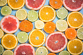 Exotic citrus slices overhead background, vibrant colors