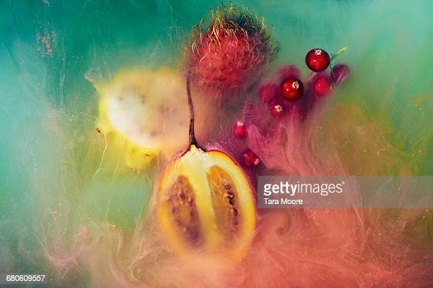exotic fruit and paint shot underwater