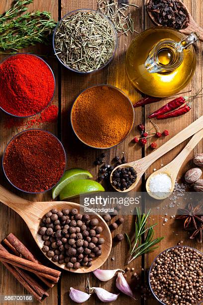 Exotic spices and herbs on rustic wood table