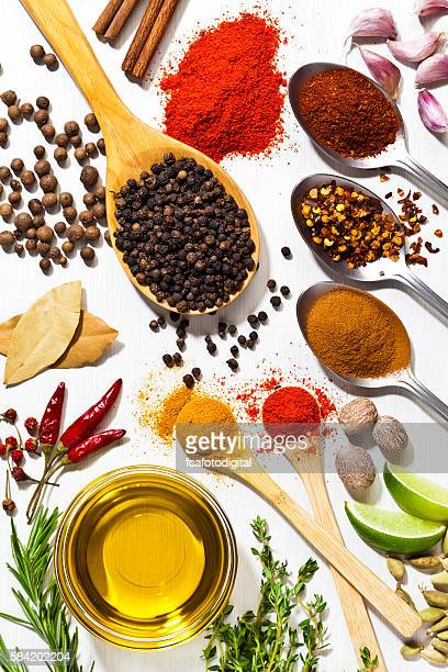 Exotic spices and herbs on white table