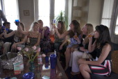 Expatriates gather at a house to celebrate and watch the royal wedding of Prince William to Catherine Middleton on television April 29 2011 in Kabul...