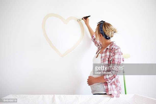 Expectant Mother Painting a Heart