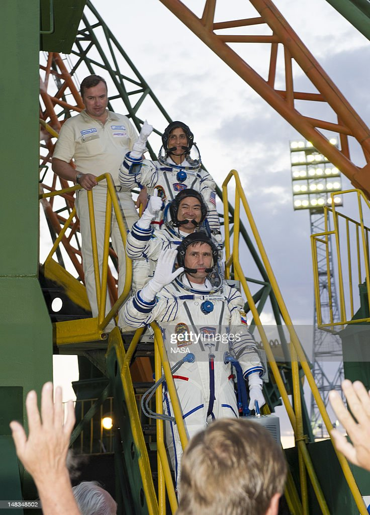 Expedition 32 Soyuz Commander Yuri Malenchenko, bottom, JAXA Flight Engineer Akihiko and NASA Flight Engineer Sunita Williams, top, wave farewell from the base of the Soyuz rocket at the Baikonur Cosmodrome on July 15, 2012 in Kazakhstan. The launch of the Soyuz spacecraft with Malenchenko, Williams and Hoshide is scheduled for 8:40 a.m. local time.