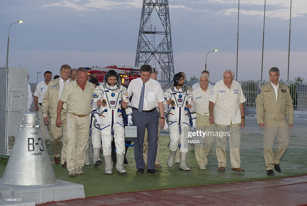 Expedition 32 Soyuz Commander Yuri Malenchenko, second from left, and NASA Flight Engineer Sunita Williams are escorted to the Soyuz rocket by senior ROSCOMOS management at the Baikonur Cosmodrome on July 15, 2012 in Kazakhstan. The launch of the Soyuz spacecraft with Malenchenko, Williams and JAXA Flight Engineer Akihiko Hoshide aboard launched at 8:40 a.m. Kazakhstan time.