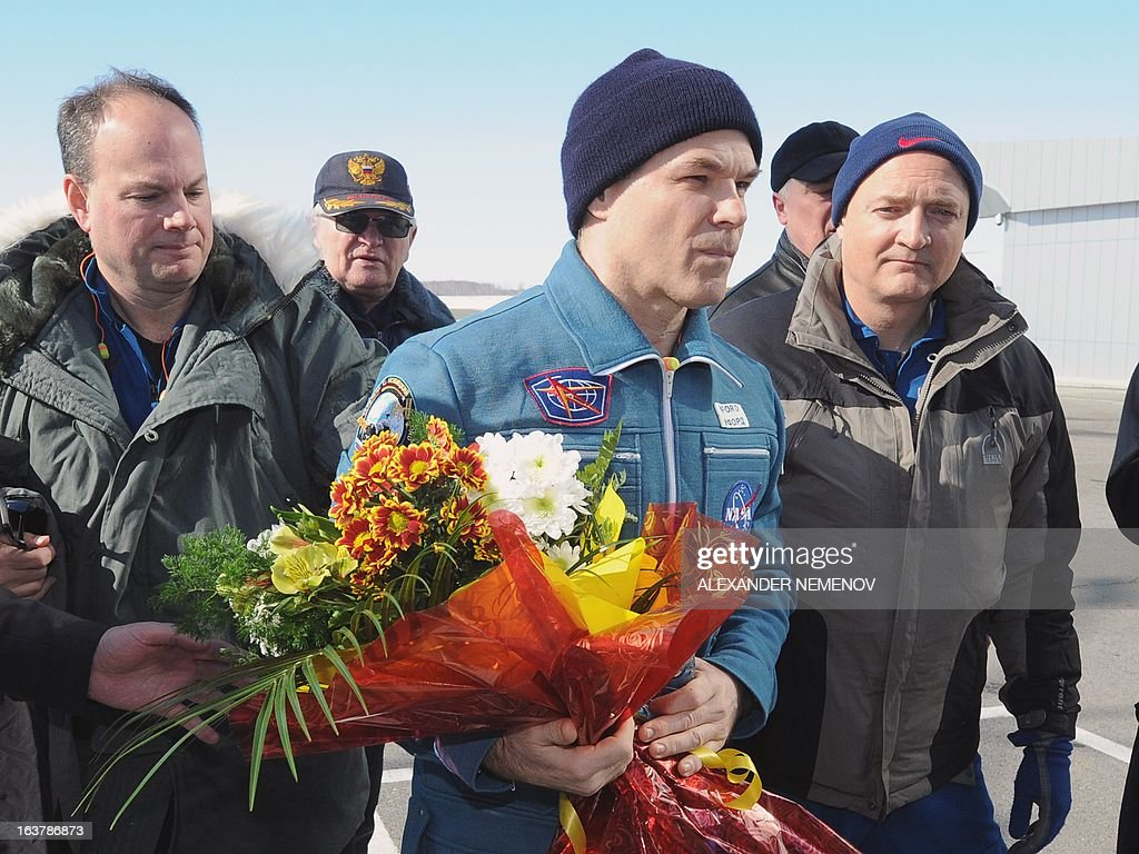 Expedition 34 Commander Kevin Ford of NASA (C) walks at the airport of Kostanay, on March 16, 2013, after their landing in northern Kazakhstan. The three astronauts, Kevin Ford, Russian Soyuz Commander Oleg Novitskiy and Russian Flight Engineer Evgeny Tarelkin, returned safely to Earth from the International Space Station early today, aboard a Russian capsule which landed on the freezing Kazakhstan steppe, mission control said.