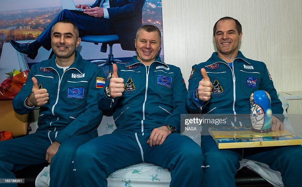 Expedition 34 Russian Flight Engineer Evgeny Tarelkin, Russian Soyuz Commander Oleg Novitskiy and Flight Commander Kevin Ford of NASA sit together at the Kustanay Airport a few hours after they landed near the town of Arkalyk on March 16, 2013 in Kusanay, Kazakhstan. Ford, Novitskiy, and Tarelkin are returning from 142 days onboard the International Space Station where they served as members of the Expedition 33 and 34 crews.