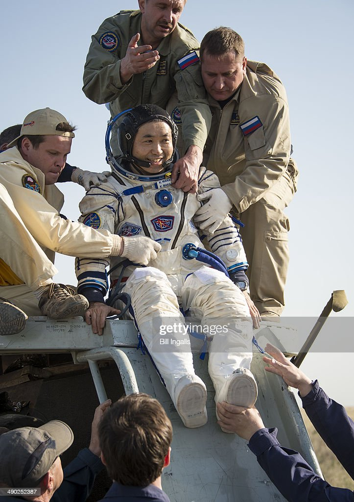 Expedition 39 Commander <a gi-track='captionPersonalityLinkClicked' href=/galleries/search?phrase=Koichi+Wakata&family=editorial&specificpeople=220363 ng-click='$event.stopPropagation()'>Koichi Wakata</a> of the Japan Aerospace Exploration Agency (JAXA) is helped of the Soyuz Capsule just minutes after he and Soyuz Commander Mikhail Tyurin of Roscosmos, and Flight Engineer Rick Mastracchio of NASA, landed in their Soyuz TMA-11M spacecraft on May 14, 2014 near the town of Zhezkazgan, Kazakhstan. Wakata, Tyurin and Mastracchio returned to Earth after more than six months onboard the International Space Station where they served as members of the Expedition 38 and 39 crews.