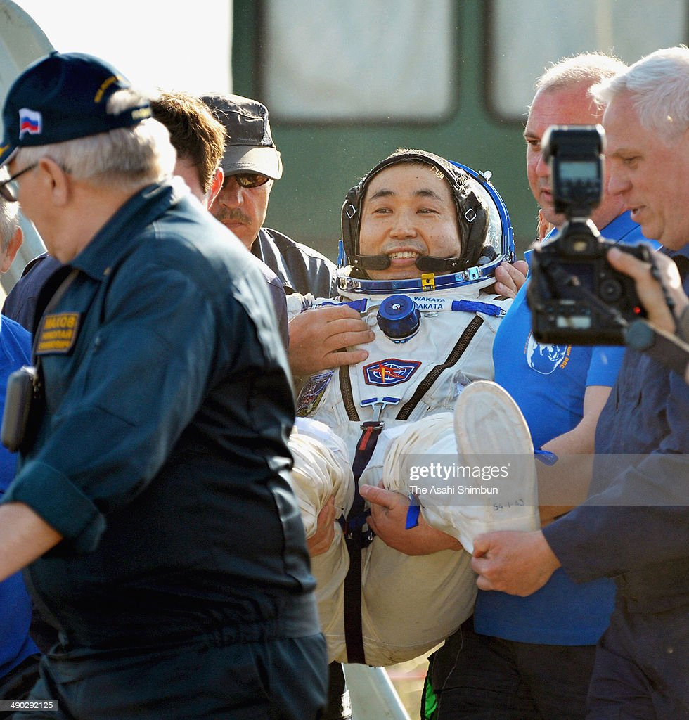 Expedition 39 Commander <a gi-track='captionPersonalityLinkClicked' href=/galleries/search?phrase=Koichi+Wakata&family=editorial&specificpeople=220363 ng-click='$event.stopPropagation()'>Koichi Wakata</a> of the Japan Aerospace Exploration Agency (JAXA) is carried minutes after landing back on the earth in their Soyuz TMA-11M on May 14, 2014 near the town of Zhezkazgan, Kazakhstan. Expedition 39 Commandar <a gi-track='captionPersonalityLinkClicked' href=/galleries/search?phrase=Koichi+Wakata&family=editorial&specificpeople=220363 ng-click='$event.stopPropagation()'>Koichi Wakata</a> of JAXA, Commander Mikhail Tyurin of Roscosmos, and Flight Engineer Rick Mastracchio of NASA returned to Earth after more than six months onboard the International Space Station where they served as members of the Expedition 38 and 39 crews.