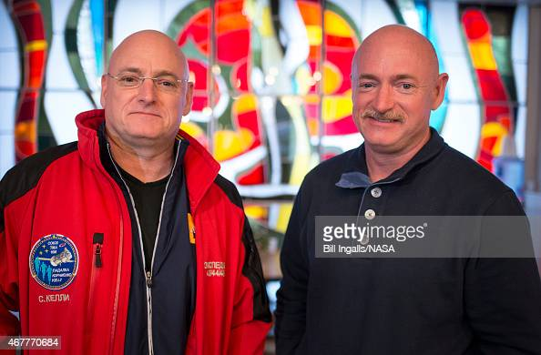 Expedition 43 NASA Astronaut Scott Kelly left and his identical twin brother Mark Kelly pose for a photograph Thursday March 26 2015 at the Cosmonaut...