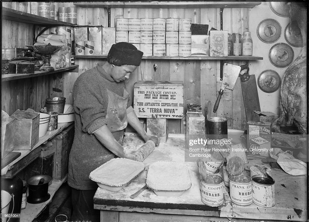 Expedition cook Thomas Clissold makes pies at camp in the Ross Dependency of Antarctica, during Captain Robert Falcon Scott's Terra Nova Expedition to the Antarctic, January 1912.