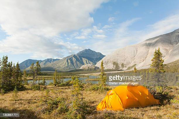 Expedition tent, arctic tundra, camping, Mackenzie Mountains behind, Wind River, Yukon Territory, Canada