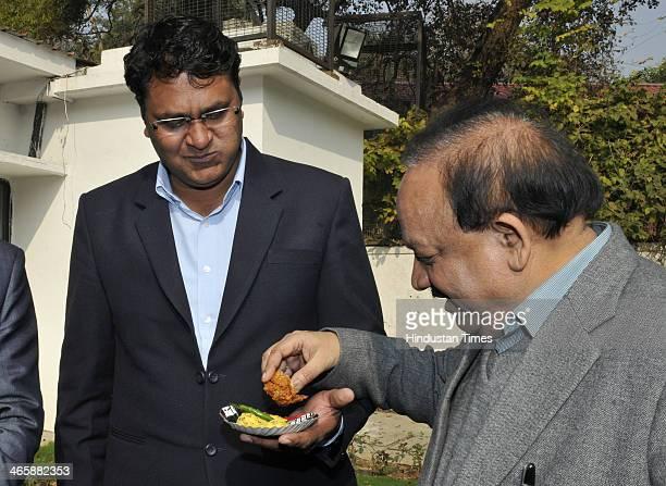 Expelled Aam Aadmi Party MLA Vinod Kumar Binny with BJP leader Harsh Vardhan during orientation programme for newly elected MLAs from Delhi at Delhi...