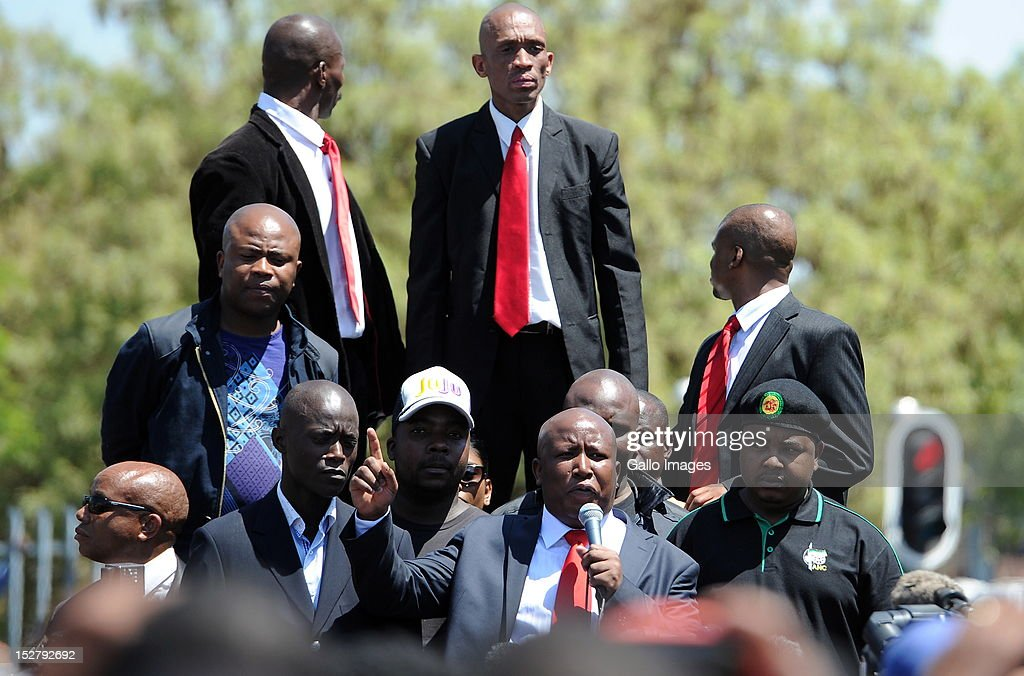 Expelled ANC Youth League President <a gi-track='captionPersonalityLinkClicked' href=/galleries/search?phrase=Julius+Malema&family=editorial&specificpeople=5866727 ng-click='$event.stopPropagation()'>Julius Malema</a> addresses his supporters outside the Polokwane Magistrates Court, following his court appearance, on September 26, 2012 in Polokwane, South Africa. There was speculation that Malema and his business associates would face charges of fraud, corruption and money laundering but only charges of money laudering were brought against him. Malema was released on bail of R10 000.