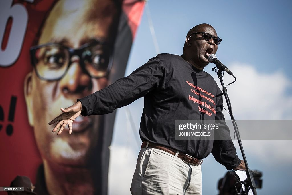 Expelled Secretary General of Congress of South African Trade Unions (COSATU) Zwelinzima Vavi addresses a crowd of National Union of Metalworkers of South Africa (NUMSA) members and supporters during a May Day rally organized by a new United Front South African labour movement at Tembisa stadium on May 1, 2016 in Tembisa. Vavi was expelled from Cosatu in March 2015 for bringing it into disrepute and causing divisions by speaking out against the ANC governments policies and saying it had failed workers. He had since launched a new union federation to rival Cosatu. / AFP / JOHN