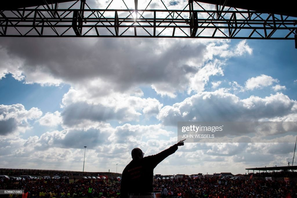Expelled Secretary General of Congress of South African Trade Unions (COSATU) Zwelinzima Vavi addresses a crowd of National Union of Metalworkers of South Africa (NUMSA) members and supporters during a May Day rally organized by a new United Front South African labour movement at Tembisa stadium on May 1, 2016 in Tembisa, South Africa. Vavi was expelled from Cosatu in March 2015 for bringing it into disrepute and causing divisions by speaking out against the ANC governments policies and saying it had failed workers. He had since launched a new union federation to rival Cosatu. / AFP / JOHN