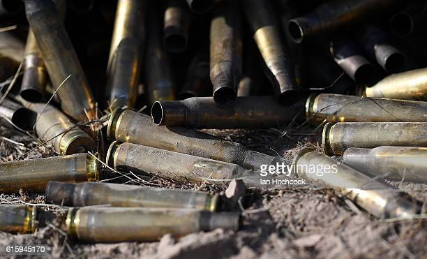 Expended bullet casings are seen laying on the ground after the completion of the live firing of 50 calibre machine guns during the 3rd Brigade Live...