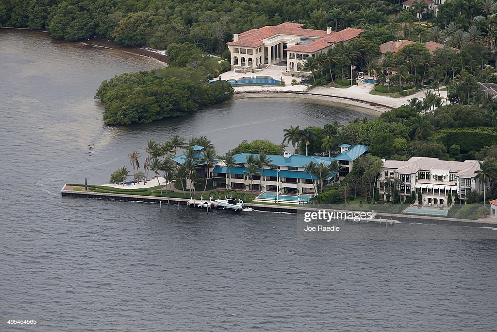 Expensive waterfront property is seen June 3, 2014 in Miami Florida. According to numerous scientists, south Florida could be flooded by the end of the century as global warming continues to melt the Arctic ice, in turn causing oceans to rise. U.S. President Barack Obama and the Environmental Protection Agency yesterday announced a rule that would reduce the nation's biggest source of pollution, carbon emissions from power plants, 30% by 2030 compared to 2005 levels. It is widely believed that these emissions are a main cause of global warming.