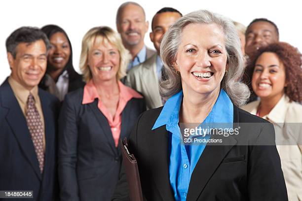 Experienced business woman in front of peers
