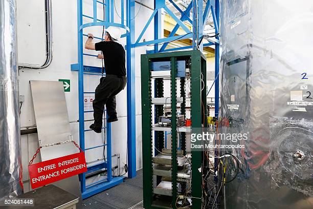 Experimental particle physicist Jasper Kirkby climbs the ladder to the top of his Cosmics Leaving Outdoor Droplets or CLOUD experiment being run at...