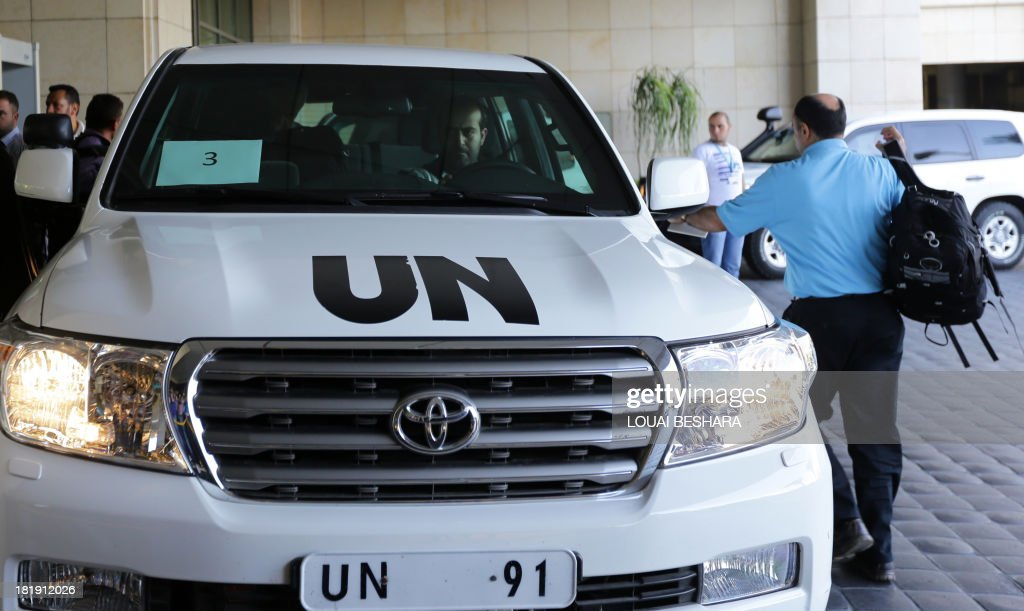 A UN expert arrives to get in a vehicle before leaving an hotel in the Syrian capital Damascus on September 26, 2013. The experts arrived in Syria on September 25 on their second mission to the country, where they will examine some 14 alleged incidents involving the use of chemical weapons.