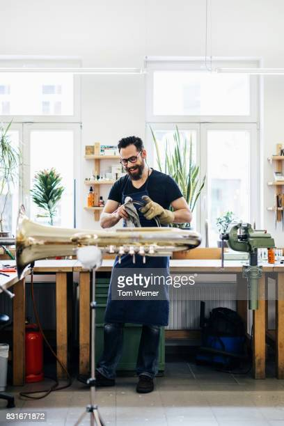 Expert Craftsman Smiling While Building Parts For Musical Instruments