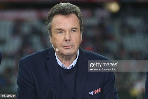 TV expert Heribert Bruchhagen looks on prior to the Bundesliga match between Bayern Muenchen and Borussia Moenchengladbach at Allianz Arena on...
