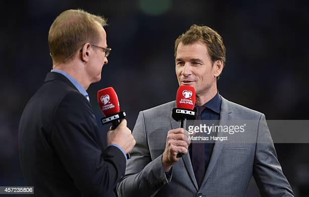 TV expert Jens Lehmann and TV presenter Florian Koenig prior to the EURO 2016 Group D qualifying match between Germany and Ireland at Veltins Arena...