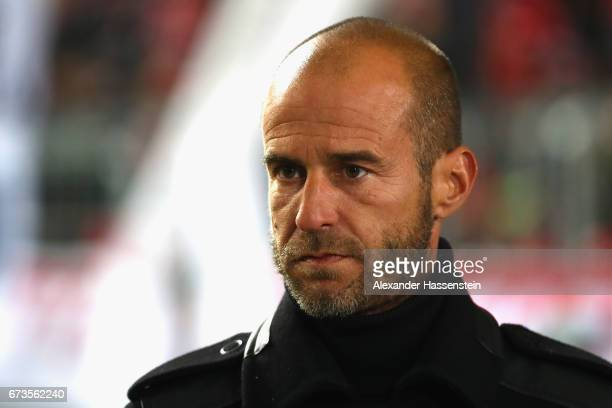 TV expert Mehmet Scholl looks on prior to the DFB Cup semi final match between FC Bayern Muenchen and Borussia Dortmund at Allianz Arena on April 26...