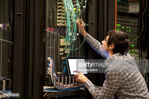 IT expert working on computer server equipment