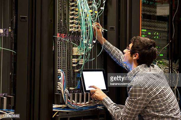 IT expert working on computer server equipment