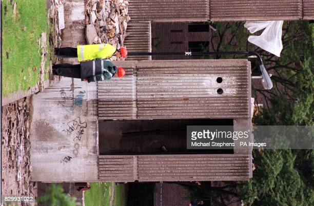 Experts inspect the area of the gas explosion which tore through a 21 storey block of flats on Hotspur Street in Kennington south London early this...