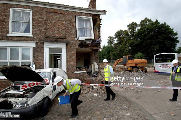 Experts inspect the damage to a house in York after it was hit Tuesday September 20 by a bus The bus driver and people in the house escaped without...