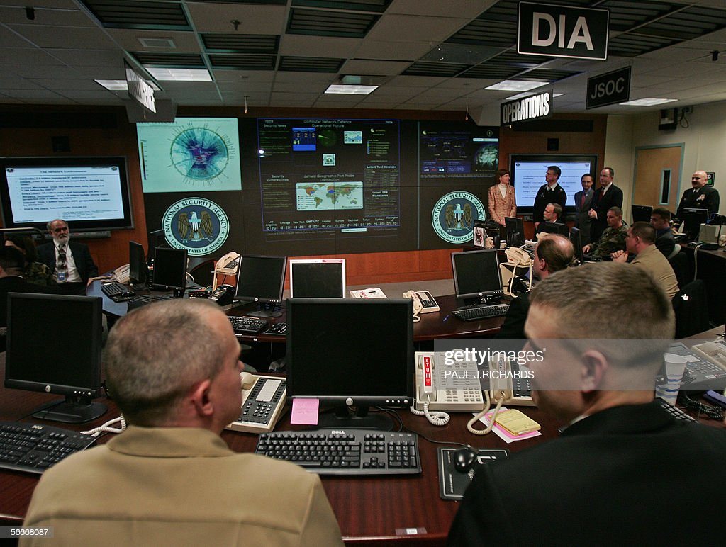 Experts man their stations at the Threat Operations Center inside the National Security Agency (NSA) 25 January 2006 in suburban Fort Mead, Maryland. US President George W. Bush delivered a speech and met with employees in advance of US Senate hearings on the administration's much-criticized domestic surveillance. AFP Photo/Paul J. RICHARDS