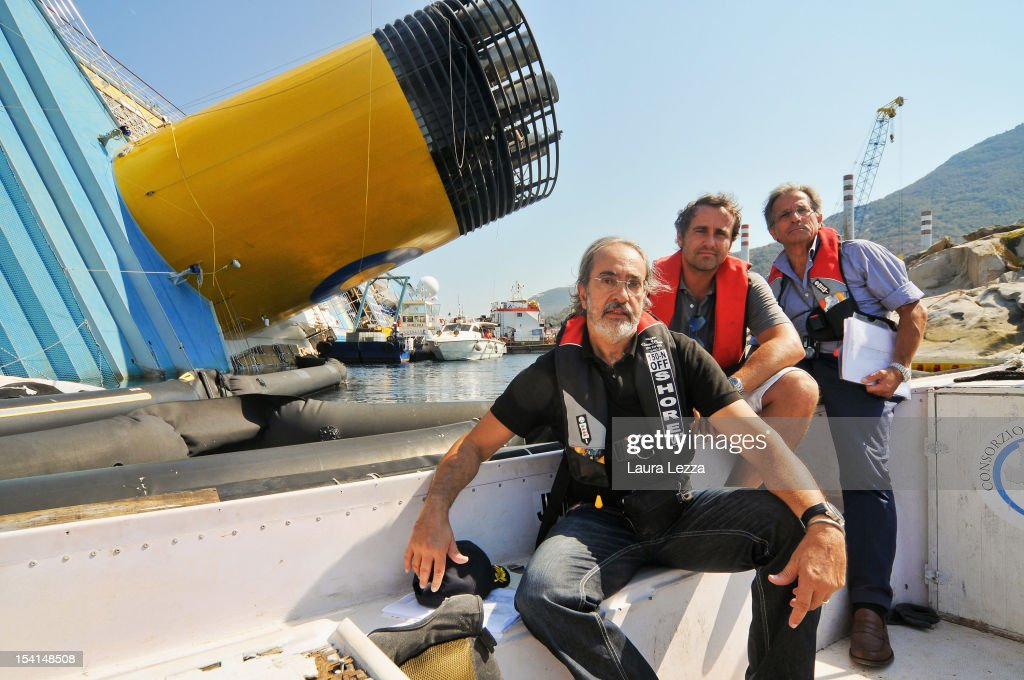 Experts of the Codacons, Professor of electronics at the University of Pisa Bruno Neri (L), lawyer Giuliano leuzzi (C) and engineer Alessandro Sommella (R), are seen as they survey and collect data for reports at Costa Concordia on July 25, 2012 in Giglio Porto, Italy. The College expert Codacons is a group of university professors and experts engaged in the work of data analysis of the black box and procedural documents relating to the investigation of the sinking of the Costa Concordia cruise liner. A preliminary court hearing into the incident starts on October 15, 2012 in Grosseto, Italy, during which experts will present their findings.