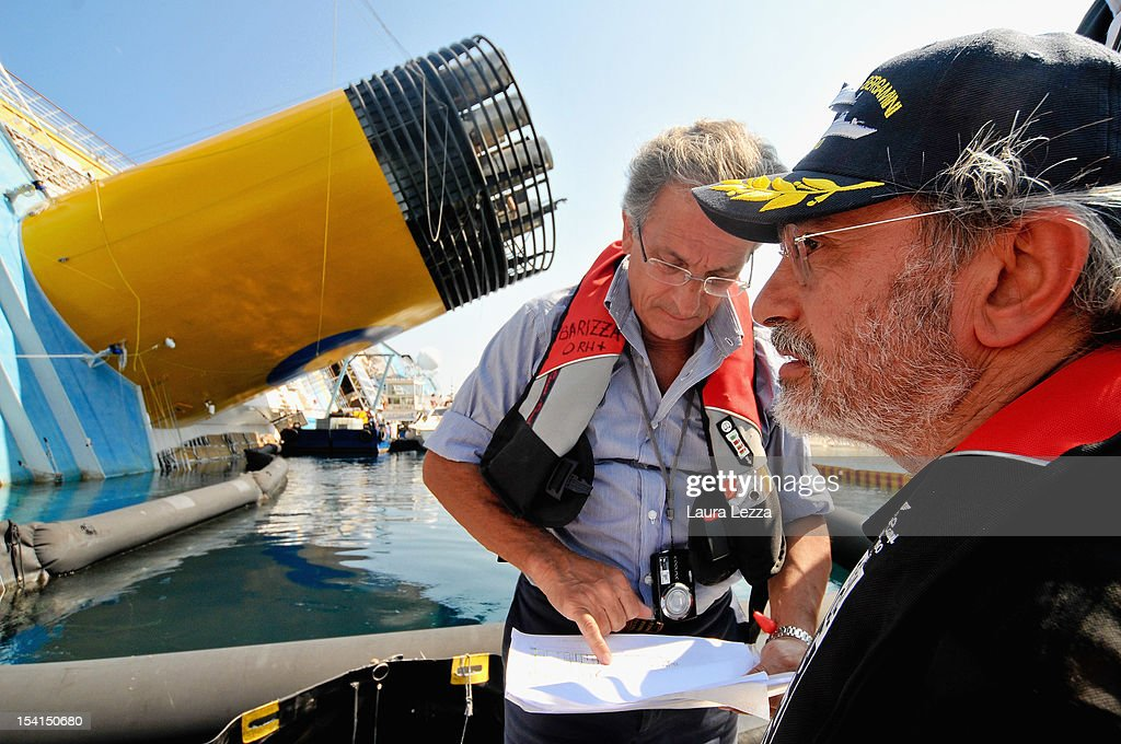 Experts of the Codacons, Professor of electronics at the University of Pisa Bruno Neri (R) and engineer Alessandro Sommella (L), are seen as they survey and collect data for reports at Costa Concordia on July 25, 2012 in Giglio Porto, Italy. The Codacons is a group of university professors and experts engaged in the work of data analysis of the black box and procedural documents relating to the investigation of the sinking of the Costa Concordia cruise liner. A preliminary court hearing into the incident starts on October 15, 2012 in Grosseto, Italy, during which experts will present their findings.