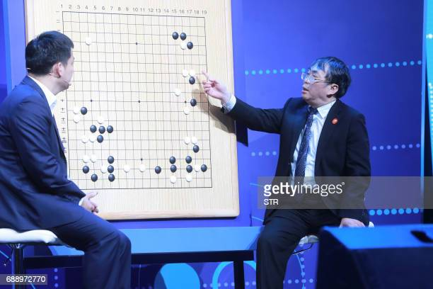 Experts review moves during the Go match between 19yearold Ke Jie and Google's artificial intelligence programme AlphaGo in Wuzhen in eastern China's...