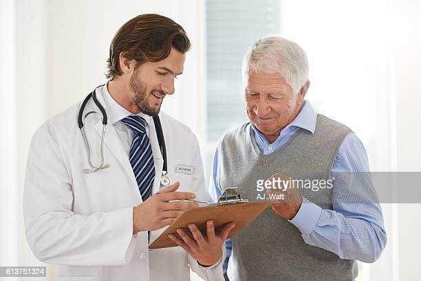 Explaining his treatment procedure