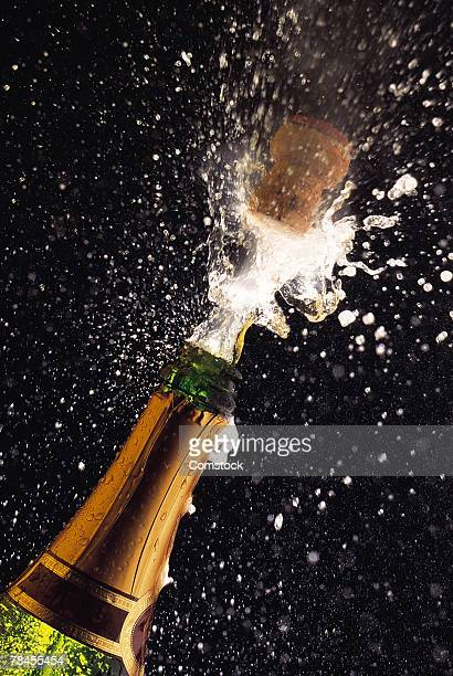 Exploding champagne bottle