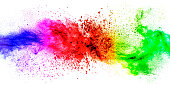 Abstract exploding colorful powder on white background.