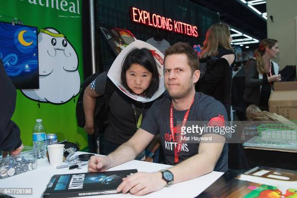 Exploding Kittens Creator Matthew Inman poses for a photo with a fan during Emerald City Comicon at Washington State Convention Center on March 3...