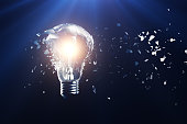 Exploding light bulb on a blue background, with concept creative thinking and innovative solutions, 3D rendering
