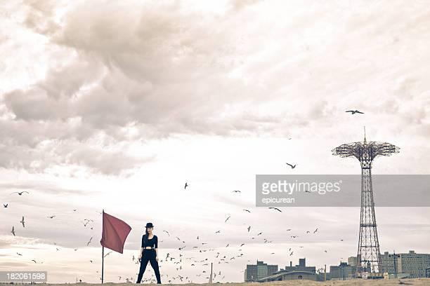 Explorer under stormy skies circled by sea gulls