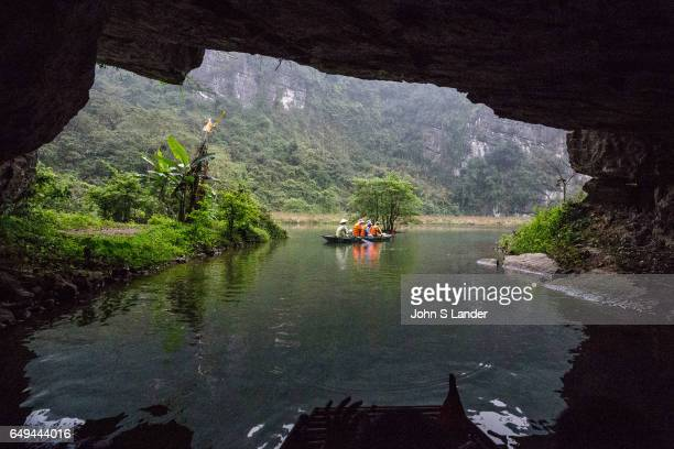 Exploring Caves by boat at Trang An Complex Trang An Landscape Complex is made up of three distinct areas Hoa Lu Ancient Citadel Trang An and Tam Coc...