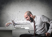 businessman destroying his computer