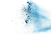 abstract blue powder splattered on white background,Freeze motion of blue powder splash. Explosion of powder on white background.